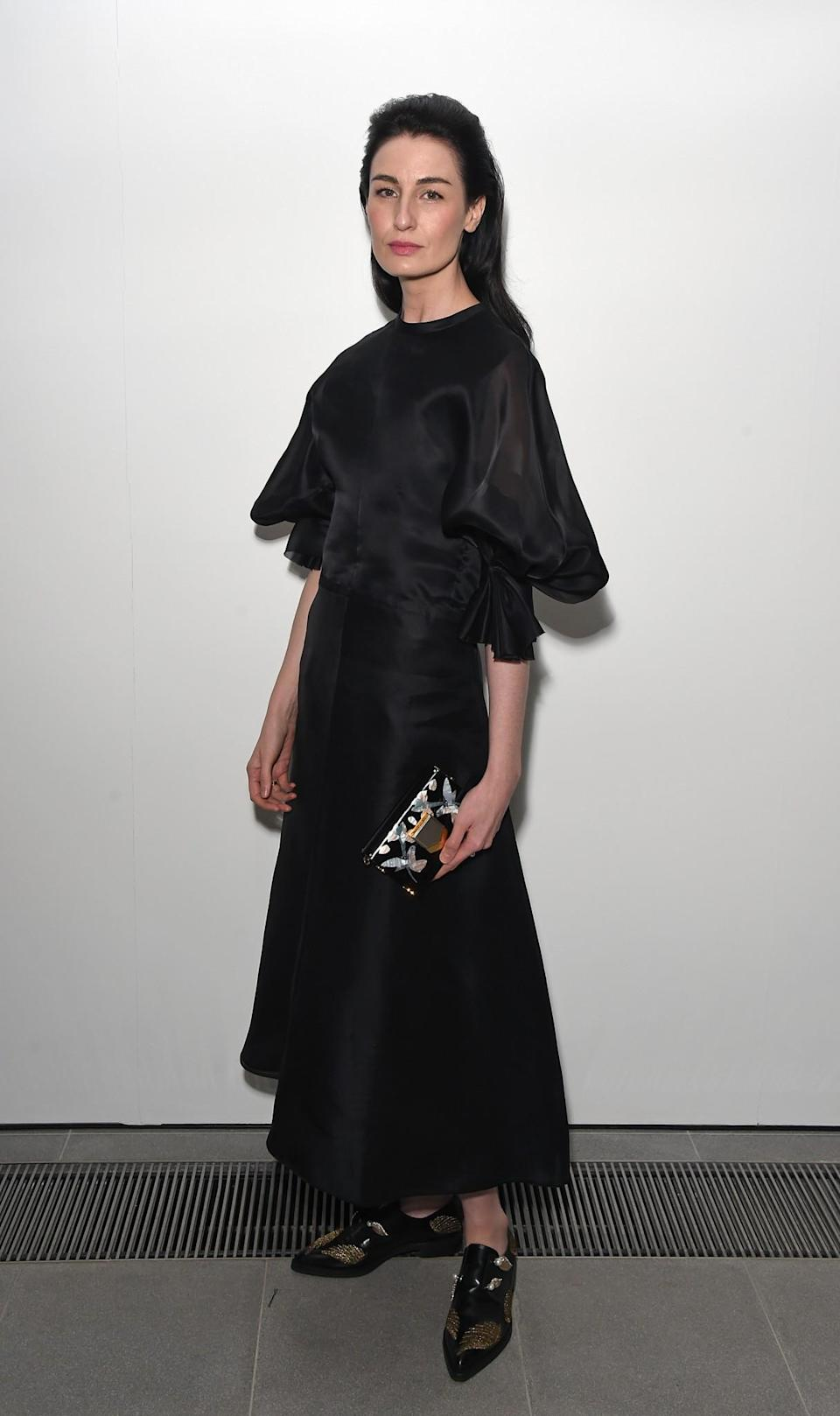 <p>Erin O'Connor turned up in flats and a long satin dress. <i>[Photo: Getty]</i> </p>