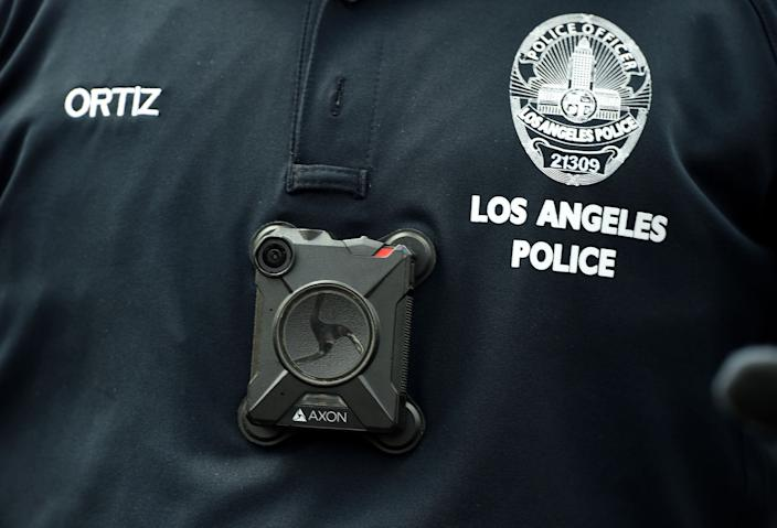 lapd body cam A Los Angeles Police Department officer wears a body camera at the Los Angeles Gay Pride Resist March, June 11, 2017 in Hollywood, California. (Photo by Robyn Beck / AFP) (Photo by ROBYN BECK/AFP via Getty Images)