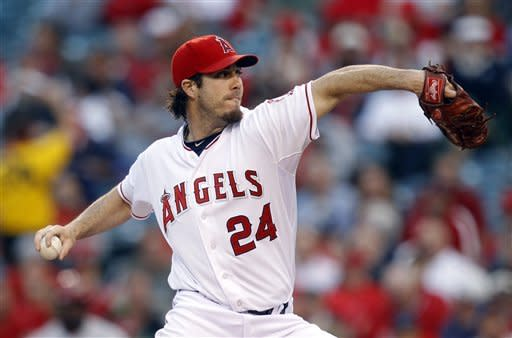 Los Angeles Angels starting pitcher Dan Haren throws against the Arizona Diamondbacks in the first inning of a baseball game in Anaheim, Calif., Friday, June 15, 2012. (AP Photo/Jae C. Hong)