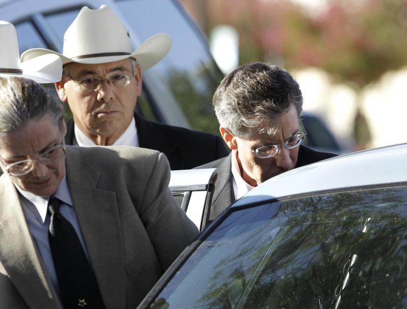 "Law enforcement personnel place Polygamist religious leader Warren Jeffs into an awaiting vehicle as he departs the Tom Green County Courthouse Thursday Aug. 4, 2011, in San Angelo, Texas.  A jury convicted Jeffs of child sexual assault Thursday, in a case stemming from two young followers he took as brides in what his church calls ""spiritual marriages."" (AP Photo/Tony Gutierrez)"