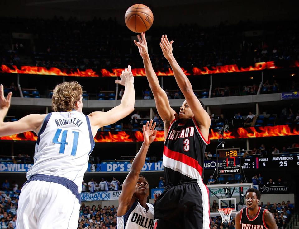 C.J. McCollum and Dirk Nowitzki went shot-for-shot down the stretch on Tuesday. (Getty Images)