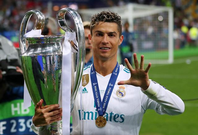 Soccer Football - Champions League Final - Real Madrid v Liverpool - NSC Olympic Stadium, Kiev, Ukraine - May 26, 2018 Real Madrid's Cristiano Ronaldo gestures as he celebrates winning the Champions League with the trophy REUTERS/Hannah McKay