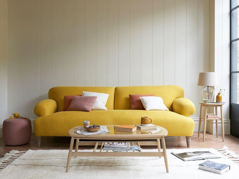 """<p>A joyful choice just making it into the top 10 most popular sofa colours for 2021. A soft yolky yellow like this Easy Peasy sofa from Loaf brightens up a room, and is a deceptively versatile centrepiece, sitting comfortably with natural materials, shades of rusty red, forest green and even burnt orange. </p><p>Pictured:<a href=""""https://loaf.com/products/easy-peasy-sofa?slide=1"""" rel=""""nofollow noopener"""" target=""""_blank"""" data-ylk=""""slk:Easy-Peasy Sofa at Loaf"""" class=""""link rapid-noclick-resp""""> Easy-Peasy Sofa at Loaf</a></p>"""