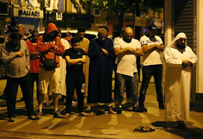 <p>JUN. 19, 2017 – Men pray after a vehicle collided with pedestrians near a mosque in the Finsbury Park neighborhood of North London, Britain. A van plowed into worshippers in the early hours of Monday, injuring 11 people, two of them seriously, in what Prime Minister Theresa May said was a sickening, terrorist attack on Muslims. (Photo: Neil Hall/Reuters) </p>