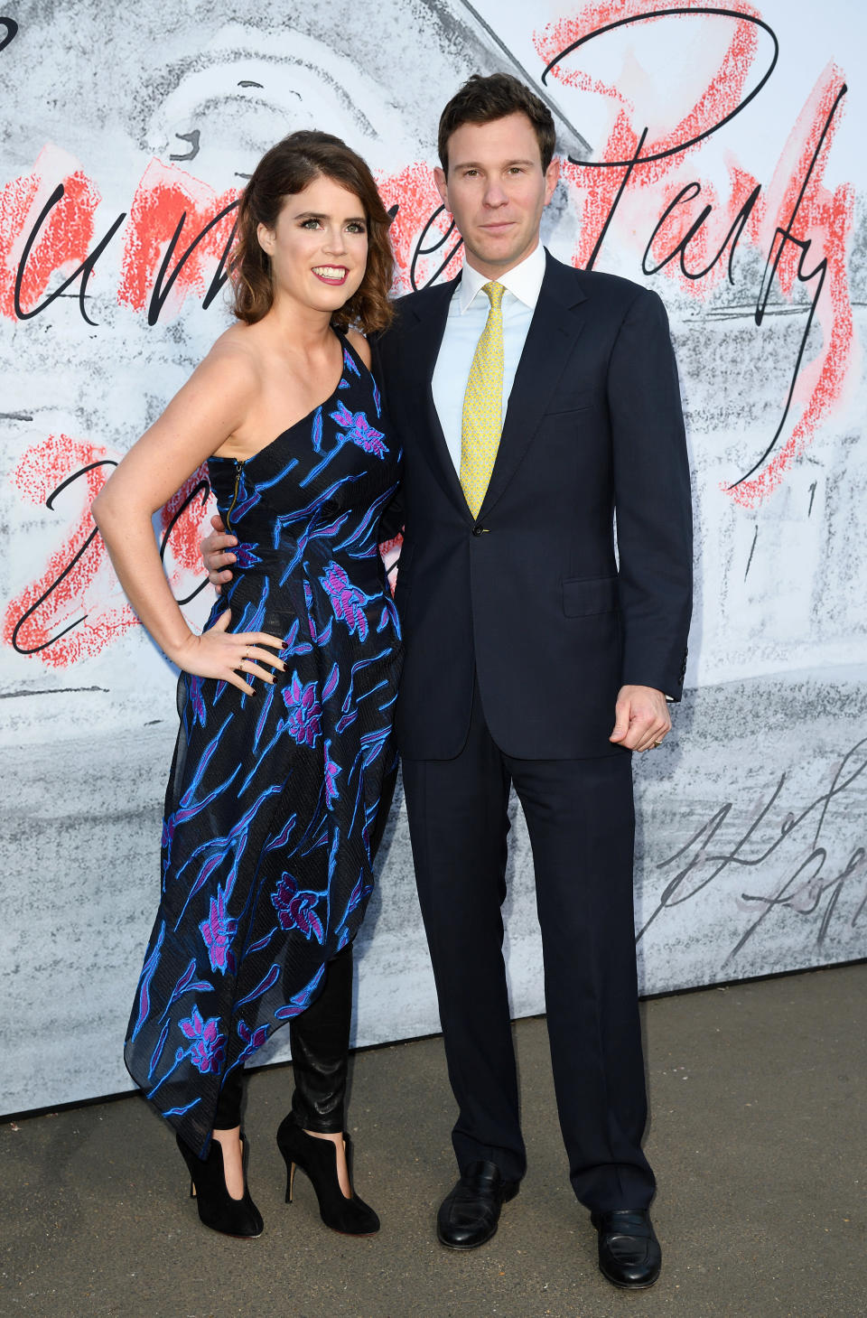 <p>Princess Eugenie and future husband Jack Brooksbank joined A-list guests at the annual Serpentine Summer Party on 19 July. For the evening event, Eugenie eschewed royal tradition in favour of a one-shoulder dress and leather-look trousers. <em>[Photo: Getty]</em> </p>