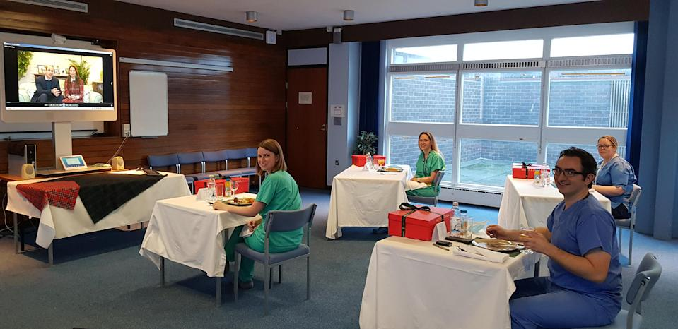 NHS staff enjoy their haggis as they watch William and Kate's video message (Kensington Palace/NHS Tayside)