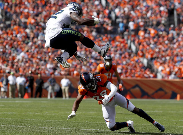 <p>Seattle Seahawks running back Chris Carson, above, gets over Denver Broncos defensive back Bradley Roby during the first half of an NFL football game Sunday, Sept. 9, 2018, in Denver. (AP Photo/David Zalubowski) </p>