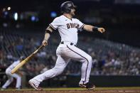 Arizona Diamondbacks' Stephen Vogt watches his run-scoring single get through to the infield during the second inning of a baseball game against the Milwaukee Brewers' Monday, June 21, 2021, in Phoenix. (AP Photo/Ross D. Franklin)