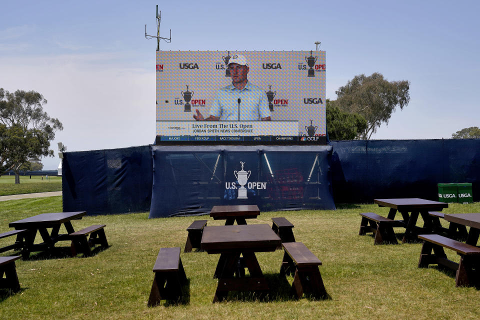 A televised press conference of Jordan Spieth is aired in an empty food court during a practice round of the U.S. Open Golf Championship, Tuesday, June 15, 2021, at Torrey Pines Golf Course in San Diego. (AP Photo/Jae C. Hong)