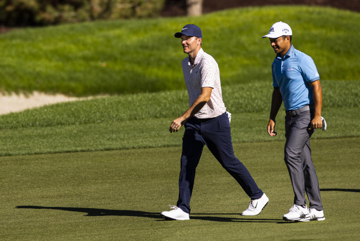 Russell Henley, left, talks with Xander Schauffele as they walk on the fairway at the 12th hole during the third round of the CJ Cup golf tournament at Shadow Creek Golf Course, Saturday, Oct. 17, 2020, in North Las Vegas. (Chase Stevens/Las Vegas Review-Journal via AP)