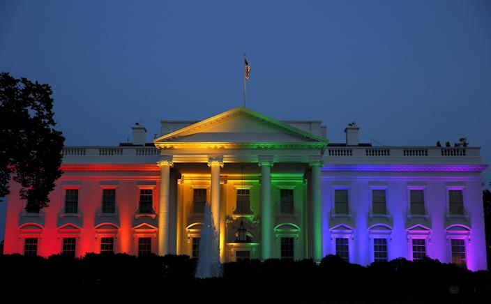 The White House is illuminated in rainbow colors after today's historic Supreme Court ruling legalizing gay marriage in Washington June 26, 2015. REUTERS/Gary Cameron TPX IMAGES OF THE DAY