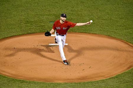FILE PHOTO: Oct 13, 2018; Boston, MA, USA; Boston Red Sox starting pitcher Chris Sale (41) pitches during the first inning against the Houston Astros in game one of the 2018 ALCS playoff baseball series at Fenway Park. Mandatory Credit: Brian Fluharty-USA TODAY Sports