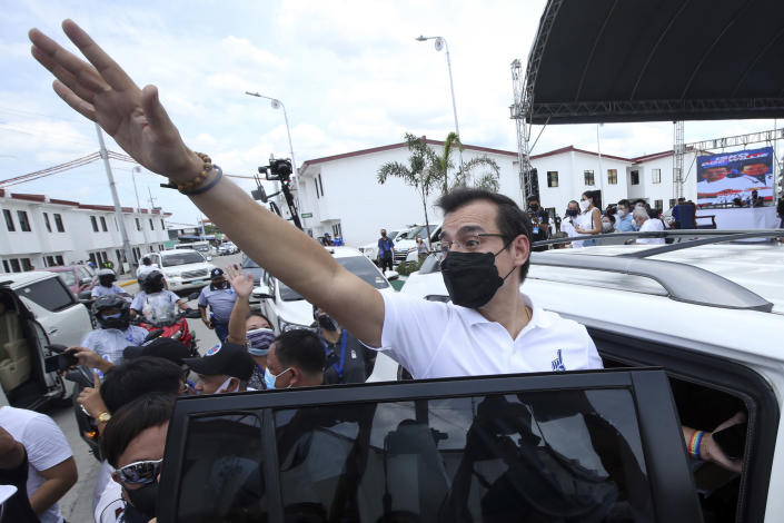 Manila Mayor Isko Moreno waves after he declared his bid to run for president in a speech at a public school in the slum area near the place where he grew up in Manila, Philippines on Wednesday Sept. 22, 2021. The popular mayor of the Philippine capital said Wednesday he will run for president in next year's elections, the latest aspirant in what is expected to be a crowded race to succeed the controversial Rodrigo Duterte. (AP Photo)