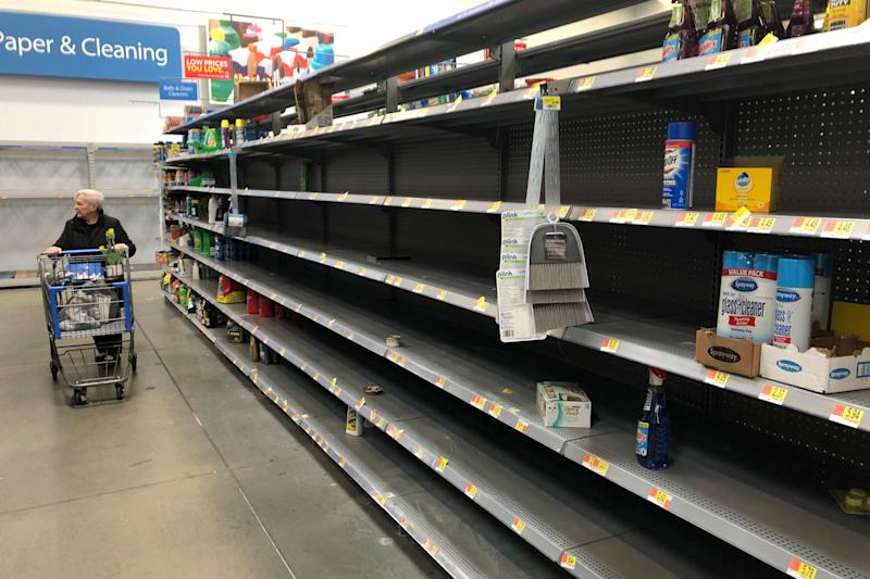 Shelves are nearly empty at a Walmart in Warrington, Pennsylvania, on March 17.Walmart has said it will provide up to two weeks' pay for employees who test positive for COVID-19. (ASSOCIATED PRESS)