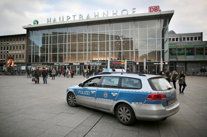 Police car drives past a train station in Cologne on January 5, 2015 (AFP Photo/Oliver Berg)