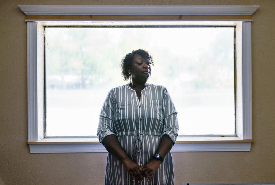 """Latonya Crowley, mother of Warren Williams, stands for a portrait in Palatka, Fla., Thursday, April 22, 2021. An FBI probe revealed a murder plot against her son by klansmen working as prison guards where Williams was once an inmate. """"In the state of mind that he's in today. I don't see him getting better,"""" Crowley says, as she and her son live today with uncertainty and paranoia. One of the guards' imminent release and the specter of other klansmen have made it impossible for Williams to move on. (AP Photo/David Goldman)"""