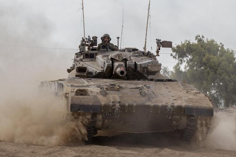 An Israeli army Merkava tank rolls along the Israel's border with the Gaza Strip on July 24, 2014