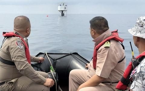 Thai naval officers from the Third Naval Area Command and Marine policemen inspect the 'Seastead'' in the Andaman Sea, - Credit: Rex