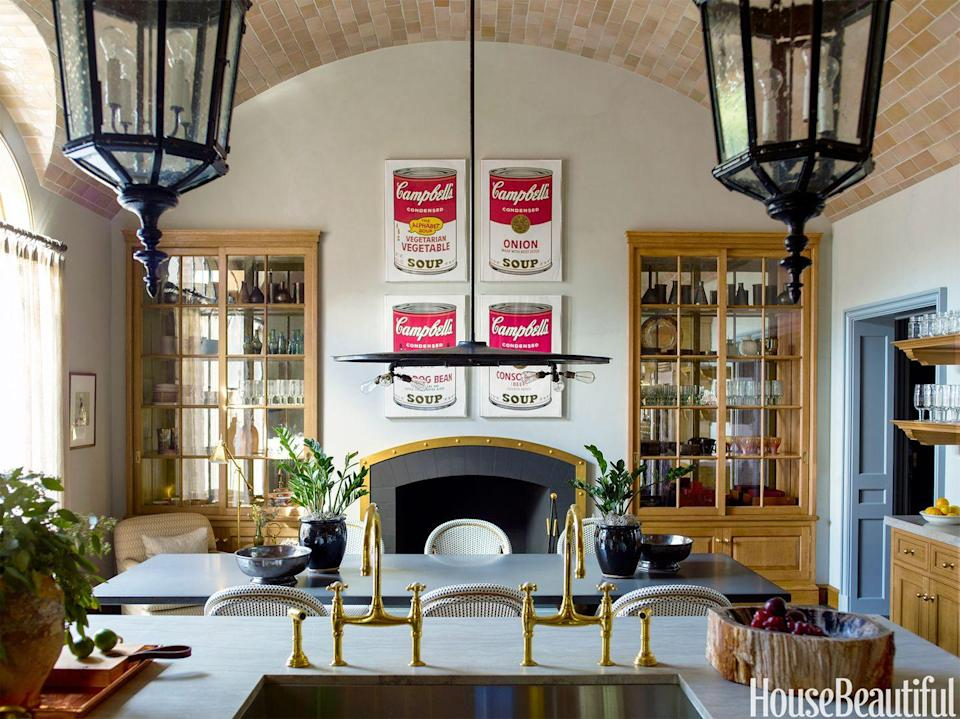 <p>When you want a pop of color but don't have the space, budget, or gall to invest in vibrant fixtures or paint, introduce some lively wall art instead, like Steven Gambrel did here (albeit with art that's not <em>exactly</em> budget). You can get the same effect sans Warhol prices using posters or large prints. </p>