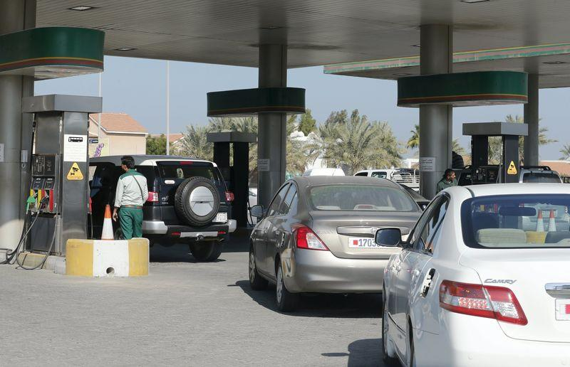 Cars line up to refuel at a petrol station in Budaiya