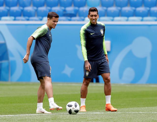 Soccer Football - World Cup - Brazil Training - Saint Petersburg Stadium, Saint Petersburg, Russia - June 21, 2018 Brazil's Philippe Coutinho and Roberto Firmino during training REUTERS/Henry Romero