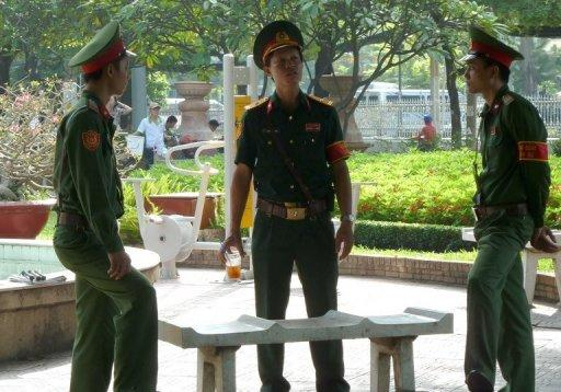 <p>This file photo shows soldiers guarding at a public park next to the Ho Chi Minh City People's Court, in 2011. Hundreds of police surrounded a court in Ho Chi Minh City on Monday for the opening of the trial of three bloggers, including one whose case has been raised by US President Barack Obama.</p>