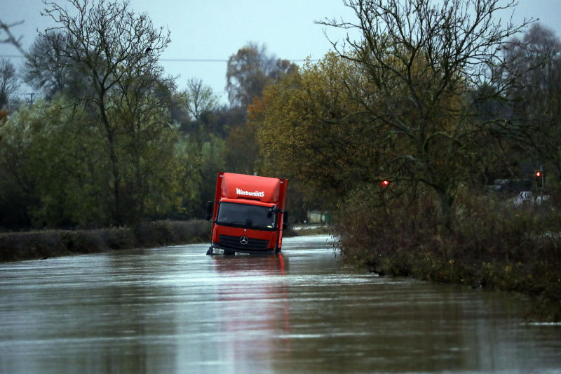 A lorry is stranded on a flooded road near Eckington, Worcestershire, after heavy rain. (Photo by Steve Parsons/PA Images via Getty Images)