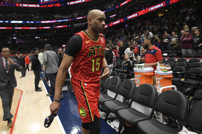 Atlanta Hawks guard Vince Carter (15) leaves the court after an NBA basketball game against the Washington Wizards, Friday, March 6, 2020, in Washington. The Wizards won 118-112. (AP Photo/Nick Wass)