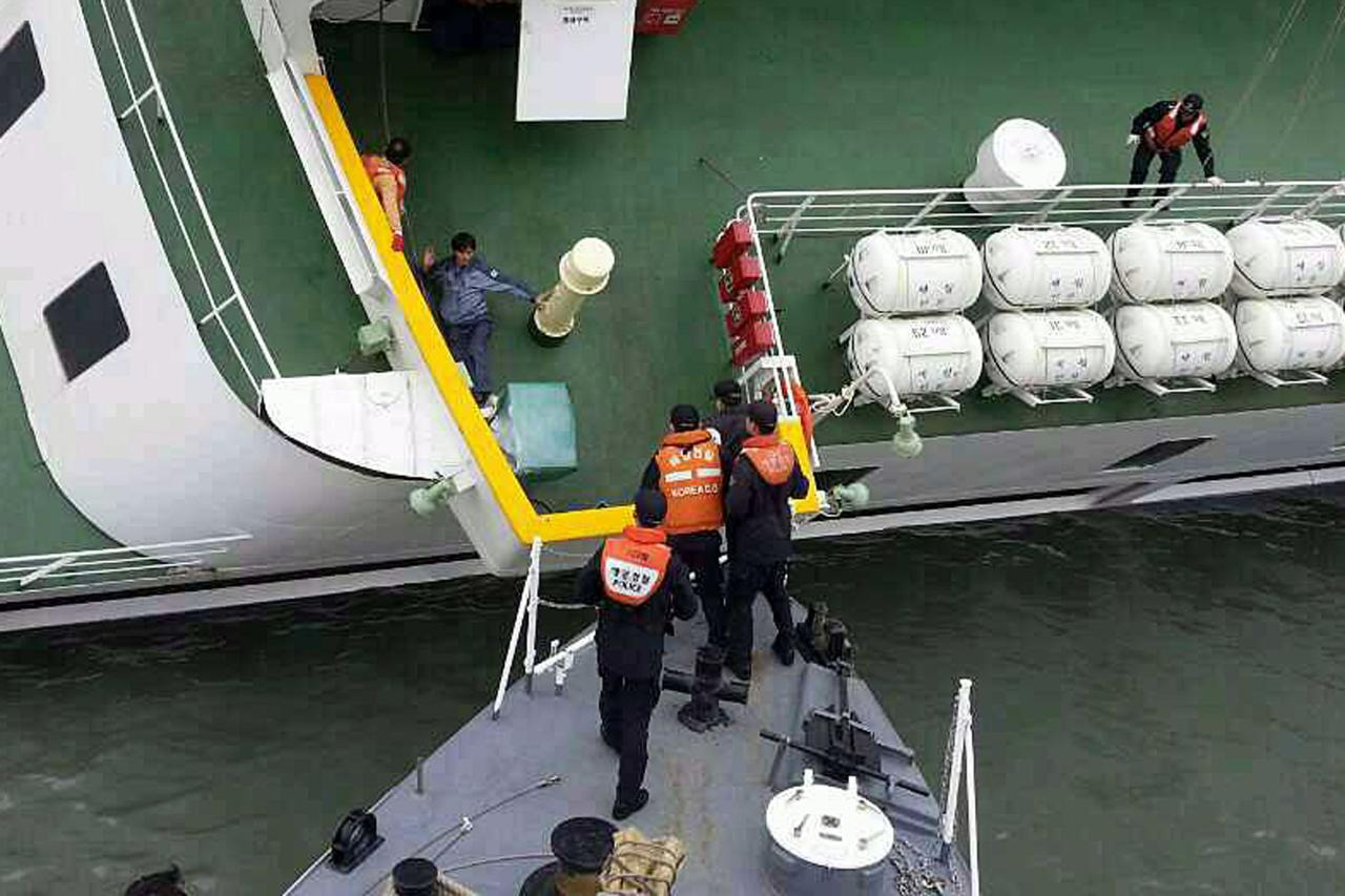 "A passenger is rescued by South Korean maritime policemen from a sinking ship ""Sewol"" in the sea off Jindo April 16, 2014, in this picture provided by Korea Coast Guard and released by Yonhap. More than 100 people remained missing on Wednesday after a South Korean ferry with 477 people aboard capsized off the country's southwest coast, Yonhap news agency said. REUTERS/Korea Coast Guard/Yonhap (SOUTH KOREA - Tags: DISASTER MARITIME) ATTENTION EDITORS - THIS IMAGE WAS PROVIDED BY A THIRD PARTY. FOR EDITORIAL USE ONLY. NOT FOR SALE FOR MARKETING OR ADVERTISING CAMPAIGNS. THIS PICTURE IS DISTRIBUTED EXACTLY AS RECEIVED BY REUTERS, AS A SERVICE TO CLIENTS. NO SALES. NO ARCHIVES. SOUTH KOREA OUT. NO COMMERCIAL OR EDITORIAL SALES IN SOUTH KOREA"