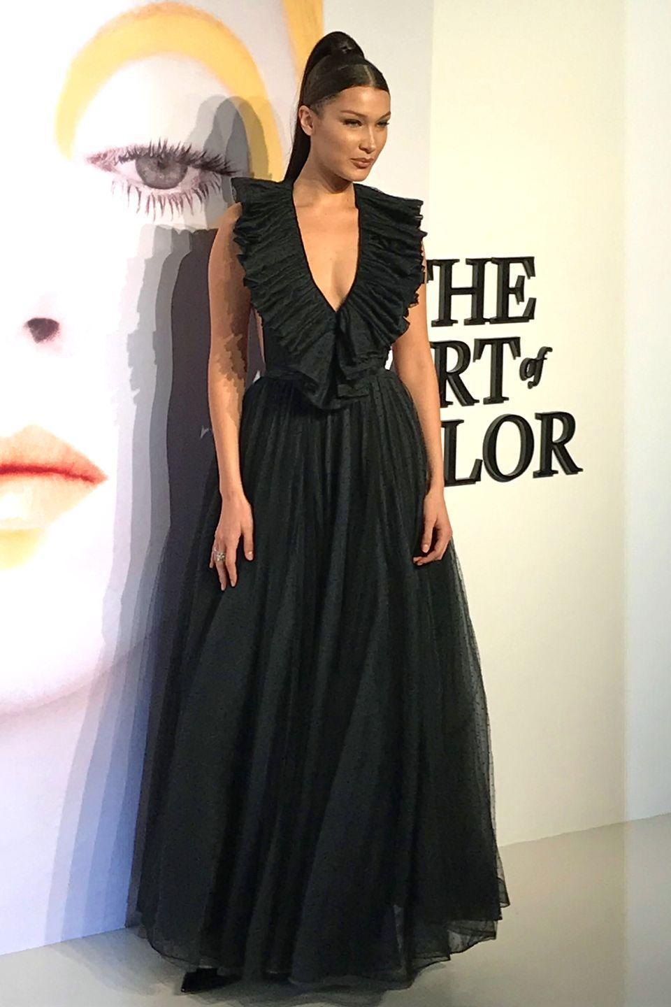"""<p>in a plunging ruffled black tulle gown by Dior at the designer's, The Art of Color exhibition at MoCA Shanghai, <span class=""""redactor-unlink"""">China</span>. <br></p>"""
