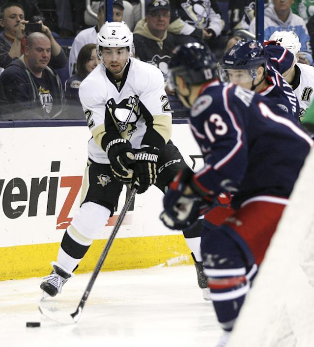 Pittsburgh Penguins' Matt Niskanen (2) controls the puck behind the Columbus Blue Jackets goal during the first period of an NHL hockey game, Friday, March 28, 2014, in Columbus, Ohio. (AP Photo/Mike Munden)