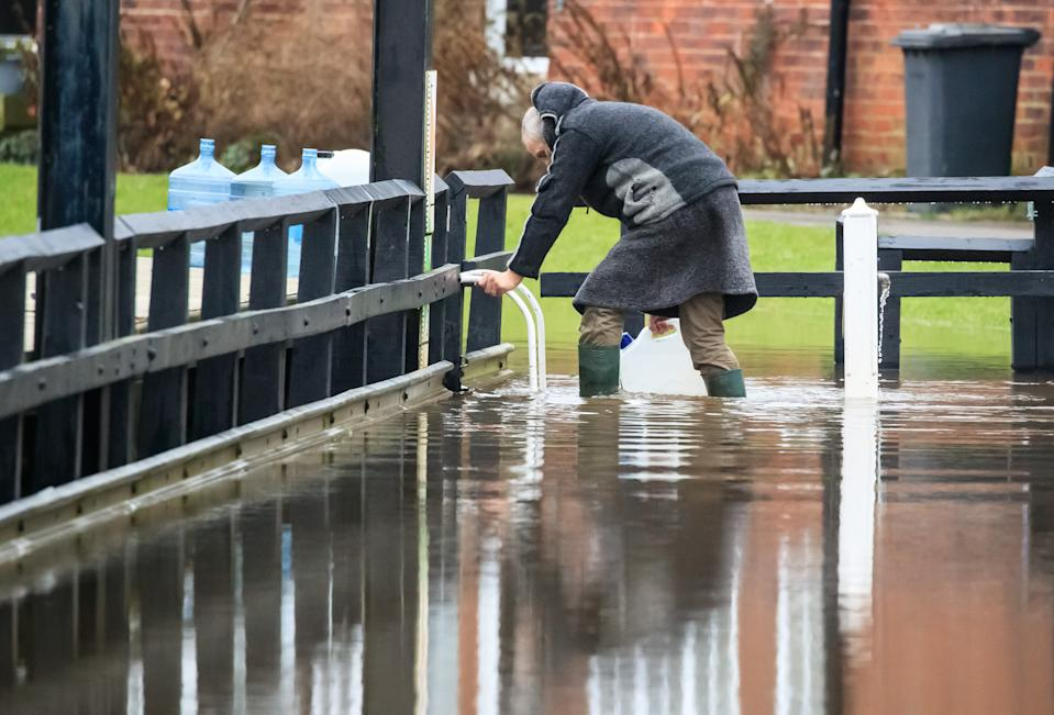 A man in flood water near Naburn Lock Caravan Park in York as Storm Christoph is set to bring widespread flooding, gales and snow to parts of the UK. Heavy rain is expected to hit the UK overnight on Tuesday, with the Met Office warning homes and businesses are likely to be flooded, causing damage to some buildings. Picture date: Tuesday January 19, 2021.in York as Storm Christoph is set to bring widespread flooding, gales and snow to parts of the UK. Heavy rain is expected to hit the UK overnight on Tuesday, with the Met Office warning homes and businesses are likely to be flooded, causing damage to some buildings. Picture date: Tuesday January 19, 2021. (Photo by Danny Lawson/PA Images via Getty Images)