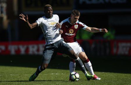 Britain Football Soccer - Burnley v Manchester United - Premier League - Turf Moor - 23/4/17 Manchester United's Paul Pogba in action with Burnley's Johann Berg Gudmundsson Reuters / Andrew Yates Livepic