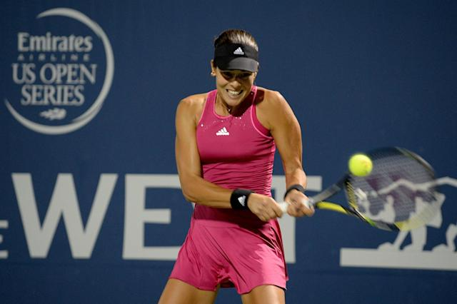 Ana Ivanovic returns to Serena Williams of the United States of America during Day 5 of the Bank of the West Classic at the Taube Family Tennis Stadium on August 1, 2014 in Stanford, California (AFP Photo/Noah Graham)
