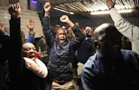 Patrons celebrate a goal by South Africa's Bongani Zungu, as they watch the Africa Cup of Nations 2019 (Afcon) quarter-final match between South Africa and Nigeria on TV at Toto's place, in Soweto
