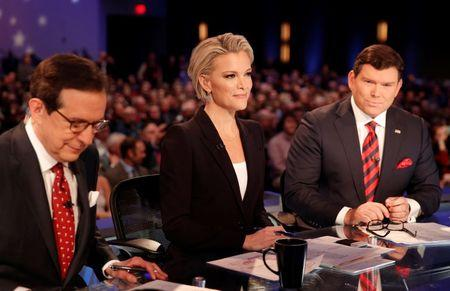Fox News Channel anchors and debate moderators (L-R) Chris Wallace, Megyn Kelly and Bret Baier begin the debate held by Fox News for the top 2016 U.S. Republican presidential candidates in Des Moines, Iowa January 28, 2016. REUTERS/Carlos Barria  - RTX24HKS