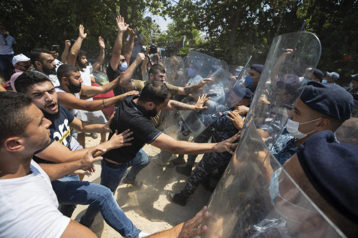 Image: Police scuffle with protesters in Beirut (Hassan Ammar / AP)