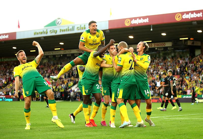 Norwich City players celebrate with Teemu Pukki after his goal against City. (Photo by Marc Atkins/Getty Images)