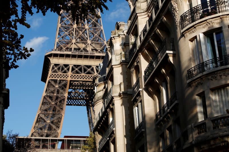 FILE PHOTO: The Eiffel Tower stands near luxury Haussmannian buildings in the 7th arrondissement district of Paris