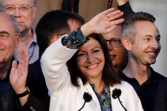 Paris mayor Anne Hidalgo waves before delivering a speech after her victorious second round of the municipal election, Sunday, June 28, 2020 in Paris. France on Sunday held the second round of municipal elections that has seen a record low turnout amid concerns over the coronavirus outbreak and anger at how President Emmanuel Macron's government handled it. (AP Photo/Christophe Ena)