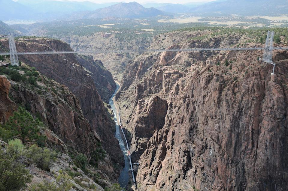 The scenic train route weaves its way far below Colorado's Royal Gorge Bridge.