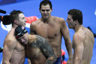 The United States' men's 4x100-meter medley relay team, Caeleb Dressel, Zach Apple, Ryan Murphy and Michael Andrew, celebrates winning the gold medal at the 2020 Summer Olympics, Sunday, Aug. 1, 2021, in Tokyo, Japan. (AP Photo/Jae C. Hong)