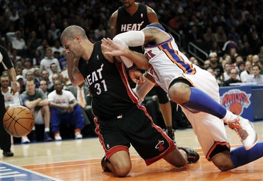 New York Knicks forward Carmelo Anthony, right, tangles with Miami Heat forward Shane Battier (31) as they fight for the ball during the second quarter of Game 3 of an NBA basketball first-round playoff series at Madison Square Garden in New York, Thursday, May 3, 2012. Anthony was called for a technical foul after the play. (AP Photo/Kathy Willens)