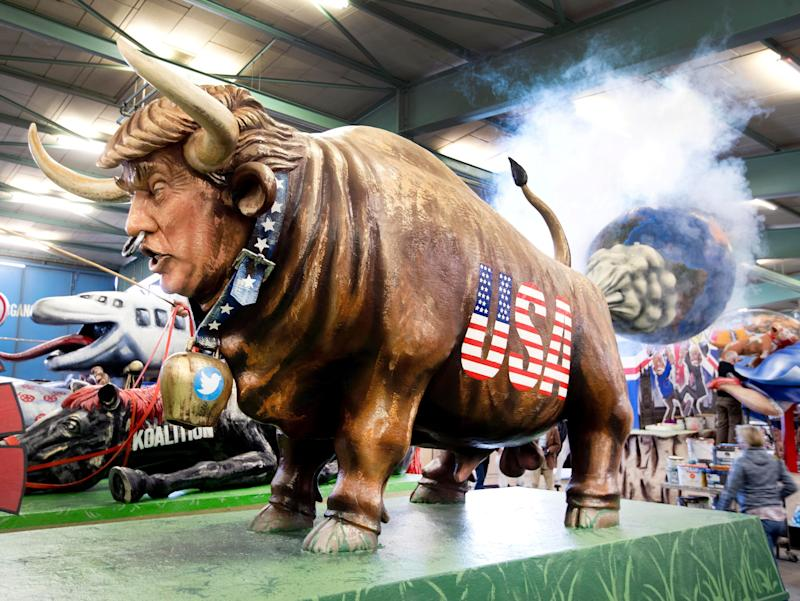 A figure depicting US President Donald Trump as a cow during a press preview in a hall of the Mainz carnival club in Mainz, Germany, Feb. 26, 2019. (Photo: Michael Probst/AP)