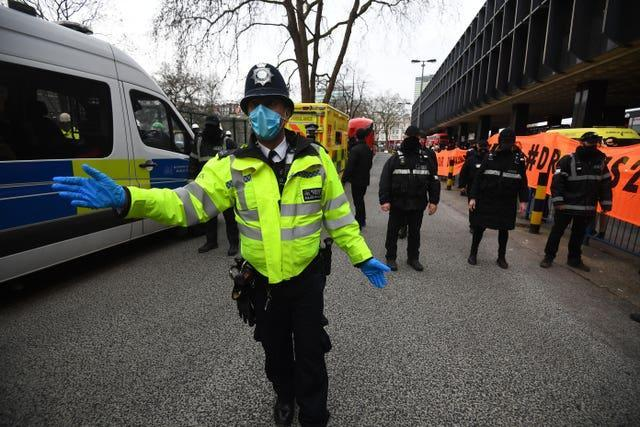 Officers from the Metropolitan Police and the National Eviction Team (NET) block the entrance to the anti-HS2 camp at Euston Square Gardens, London (Victoria Jones/PA)