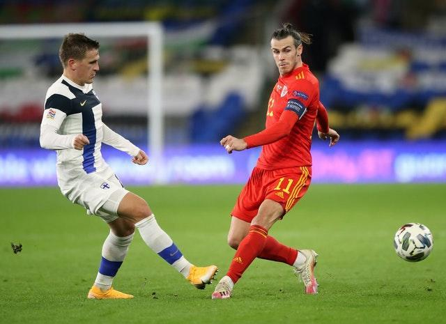 Finland's Robin Lod and Gareth Bale battle for the ball in Cardiff
