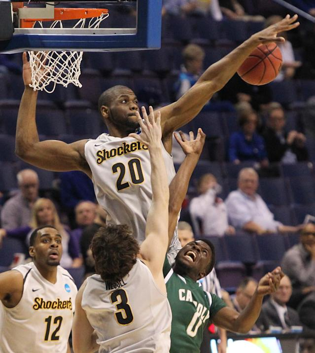 Wichita State center Kadeem Coleby, TOP, blocks a shot by Cal Poly forward David Nwaba during the first half of a second-round game in the NCAA college basketball tournament Friday, March 21, 2014, in St. Louis. (AP Photo/St. Louis Post-Dispatch, Chris Lee)