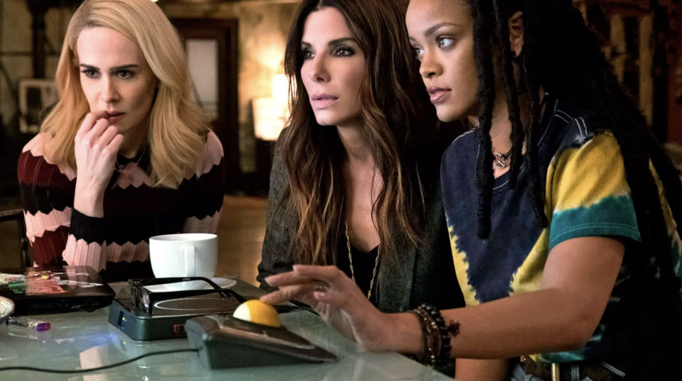 """<p>This <a rel=""""nofollow"""" href=""""https://www.yahoo.com/entertainment/sandra-bullock-assembles-star-female-heist-squad-first-oceans-8-trailer-142945147.html"""" data-ylk=""""slk:gender-swapped Ocean's 11 spin-off;outcm:mb_qualified_link;_E:mb_qualified_link;ct:story;"""" class=""""link rapid-noclick-resp yahoo-link"""">gender-swapped<em> Ocean's 11</em> spin-off</a> boasts the year's most exciting ensemble cast. Sandra Bullock stars as a criminal mastermind (and sister of George Clooney's Danny Ocean) who enlists Cate Blanchett, Rihanna, Mindy Kaling, Helena Bonham Carter, Sarah Paulson, and rapper-comedian Awkwafina in a plot to rob a wealthy actress (Anne Hathaway) at the Met Gala. 