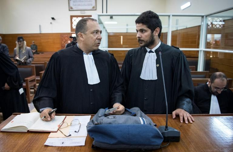 Lawyers meet before the arrival of suspected jihadists accused of murdering two Scandinavian women during a final court session in the Moroccan city of Sale on July 18, 2019 (AFP Photo/FADEL SENNA)