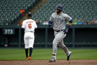 Seattle Mariners' Ryon Healy rounds the bases past Baltimore Orioles second baseman Jonathan Schoop after hitting a solo home run during the second inning of a baseball game Wednesday, June 27, 2018, in Baltimore. (AP Photo/Patrick Semansky)